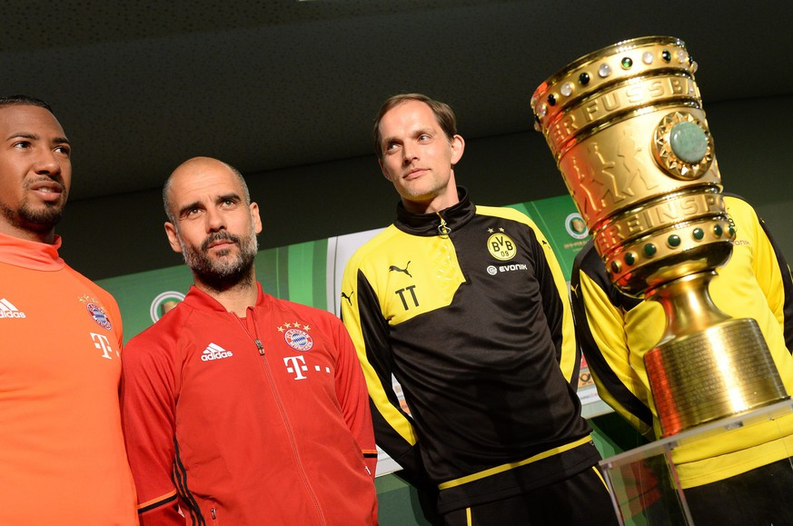 epa05319737 Jerome Boateng (L) and coach Pep Guardiola (C) of German Bundesliga soccer club FC Bayern Munich as well as coach Thomas Tuchel of Borussia Dortmund  next to the DFB Cup during the final press conference at the Olympia stadium in Berlin, Germany, 20 May 2016. On 21 May, FC Bayern Munich meets Borussia Dortmund during the finale of the German Football Association Cup.  EPA/ANDREAS GEBERT