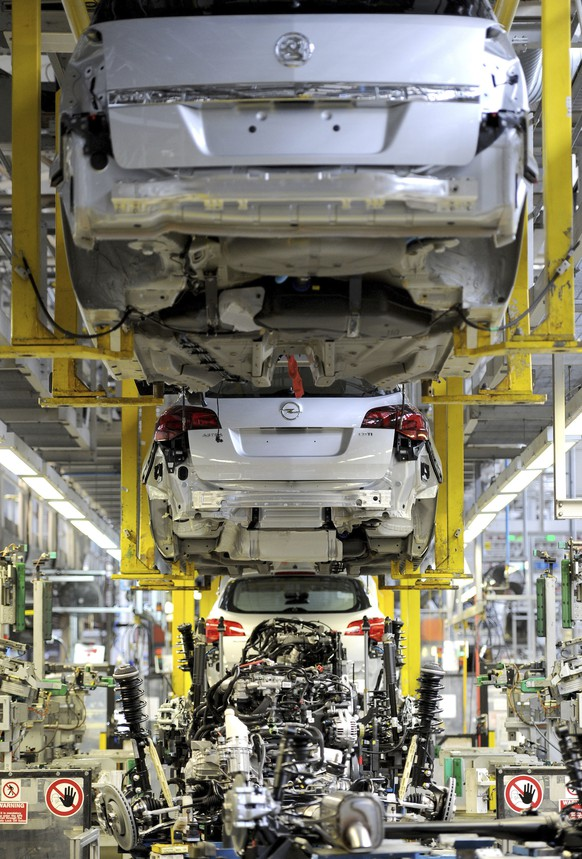 FILE - This is a March 21, 2011  file photo of the Vauxhall Astra production line at the Vauxhall Motors factory in Ellesmere Port, northwest England.  General Motors is selling its unprofitable European car business to the French maker of Peugeot, marking the American company's retreat from a major market and raising concerns of job cuts in the region. With the 2.2 billion euro ($2.33 billion) deal announced Monday, GM is giving up brands — Opel in Germany and Vauxhall in Britain — that have given it a foothold in the world's third-largest auto market since the 1920s. (Martin Rickett/PA, File via AP)