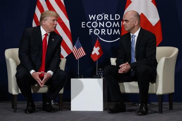 U.S. President Donald Trump, left, meets with Swiss President Alain Berset at the World Economic Forum, Friday, Jan. 26, 2018, in Davos, Switzerland. (AP Photo/Evan Vucci)