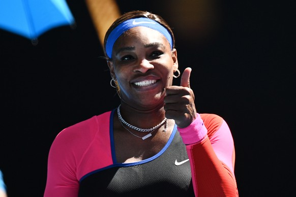 epa09011122 Serena Williams of the USA celebrates after winning her fourth Round Women's singles match against Aryna Sabalenka of Belarus on Day 7 of the Australian Open at Melbourne Park in Melbourne, Australia, 14 February 2021.  =  EPA/DEAN LEWINS AUSTRALIA AND NEW ZEALAND OUT