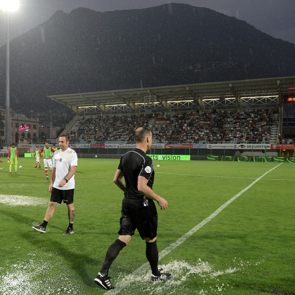The referees check the field before the suspension of the game FC Lugano against FC St. Gallen after havy rainfalls, at the Cornaredo stadium in Lugano, Saturday, July 29, 2017. (KEYSTONE/Ti-Press/Davide Agosta)