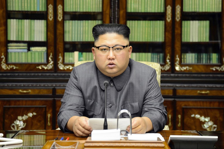 FILE - In this Thursday, Sept. 21, 2017, file photo distributed by the North Korean government, North Korean leader Kim Jong Un delivers a statement in response to U.S. President Donald Trump's speech to the United Nations, in Pyongyang, North Korea. North Korean Foreign Minister Ri Yong Ho said his country may conduct a