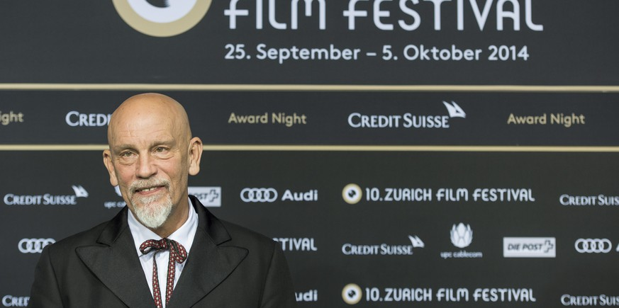epaselect epa04431959 US actor, director and producer John Malkovich poses for media on the green carpet during the 10th Zurich Film Festival in Zurich, Switzerland, 04 October 2014. Malkovich will receive late in the evening the Golden Eye award for his life's work. The Zurich Film Festival (ZFF) runs until 05 October.  EPA/ENNIO LEANZA