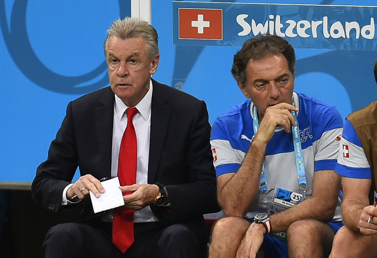 Switzerland's German coach Ottmar Hitzfeld (L) watches a Group E football match between Switzerland and France at the Fonte Nova Arena in Salvador during the 2014 FIFA World Cup on June 20, 2014.       AFP PHOTO / FABRICE COFFRINI