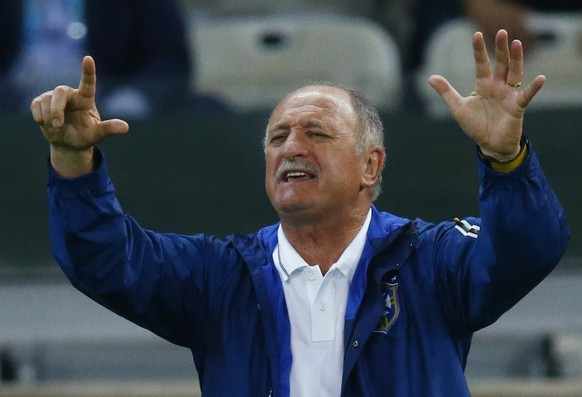 Brazil's coach Luiz Felipe Scolari gestures the number seven to his team during their 2014 World Cup semi-finals against Germany at the Mineirao stadium in Belo Horizonte in this July 8, 2014 file photo. Brazil have sacked manager Scolari just hours after the end of a home World Cup in which they suffered two of their worst defeats in the tournament's history, one of Brazil's leading newspapers reported on July 14, 2014.  REUTERS/Ruben Sprich/Files  (BRAZIL  - Tags: SOCCER SPORT WORLD CUP)