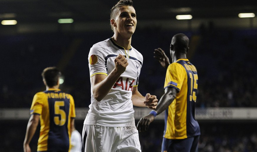 epa04460525 Tottenham's Erik Lamela (C) celebrates after scoring a goal against Asteras Tripolis  during their UEFA Europa League match in group C in White Hart Lane in London, Britain, 23 October 2014.  EPA/FACUNDO ARRIZABALAGA