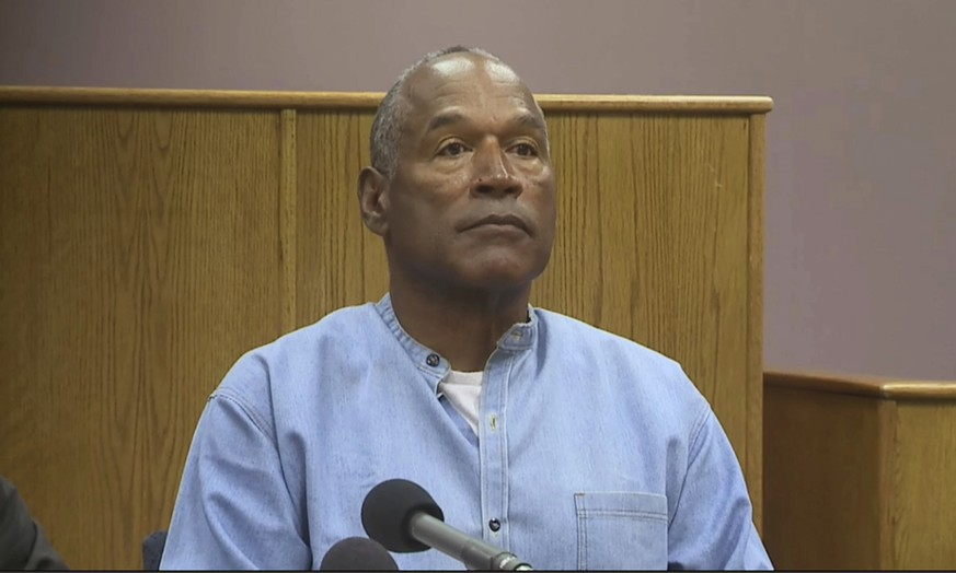 Former NFL football star O.J. Simpson appears via video for his parole hearing at the Lovelock Correctional Center in Lovelock, Nev., on Thursday, July 20, 2017.  Simpson was convicted in 2008 of enlisting some men he barely knew, including two who had guns, to retrieve from two sports collectibles sellers some items that Simpson said were stolen from him a decade earlier. (Lovelock Correctional Center via AP)