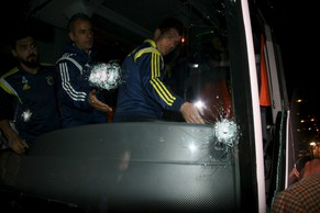 Fenerbahce's Coach Ismail Kartal and players Emre Belezoglu (R) and Bekir Irtegun (L) are seen in team bus which was shot while it has been driven through to Trabzon Airport in the Black Sea coastal province of Trabzon, northeastern Turkey late April 4, 2015. The Fenerbahce team bus was shot at on Saturday after a Turkish league game against Rizespor, the BBC reported. The coach driver was taken to hospital after sustaining injuries in the incident, which happened as champions Fenerbahce, who won the match 5-1, were travelling to Trabzon to fly back to Istanbul. No players were hurt. Picture taken April 4, 2015. REUTERS/Cihan News Agency  ATTENTION EDITORS - TURKEY OUT. THIS PICTURE WAS PROVIDED BY A THIRD PARTY. REUTERS IS UNABLE TO INDEPENDENTLY VERIFY THE AUTHENTICITY, CONTENT, LOCATION OR DATE OF THIS IMAGE. THIS PICTURE IS DISTRIBUTED EXACTLY AS RECEIVED BY REUTERS, AS A SERVICE TO CLIENTS. FOR EDITORIAL USE ONLY. NOT FOR SALE FOR MARKETING OR ADVERTISING CAMPAIGNS. NO SALES. NO ARCHIVES. THIS IMAGE HAS BEEN SUPPLIED BY A THIRD PARTY. IT IS DISTRIBUTED, EXACTLY AS RECEIVED BY REUTERS, AS A SERVICE TO CLIENTS.