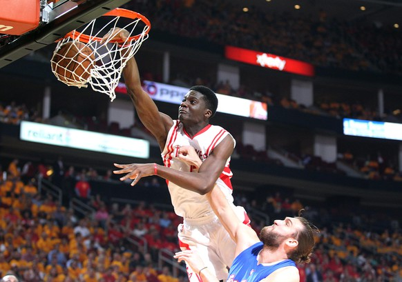 May 12, 2015; Houston, TX, USA; Houston Rockets center Clint Capela (15) dunks against Los Angeles Clippers forward Spencer Hawes (10) in the first half in game five of the second round of the NBA Playoffs. at Toyota Center. Mandatory Credit: Thomas B. Shea-USA TODAY Sports