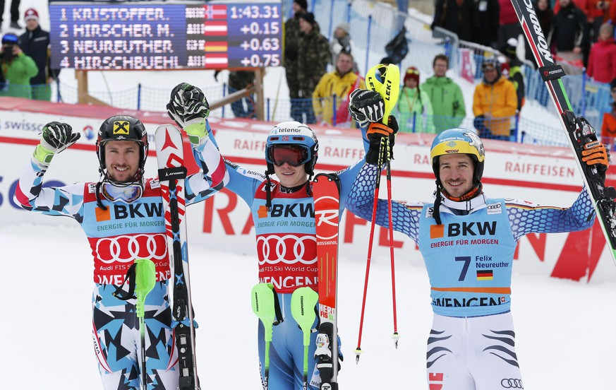 Alpine Skiing - FIS Alpine Skiing World Cup - Men's Special Slalom - Wengen, Switzerland - 15/01/17 - Winner Henrik Kristoffersen of Norway is flanked by Austria's second placer Marcel Hirscher (L) and Germany's third placer Felix Neureuther in the finish.        REUTERS/Denis Balibouse          TPX IMAGES OF THE DAY