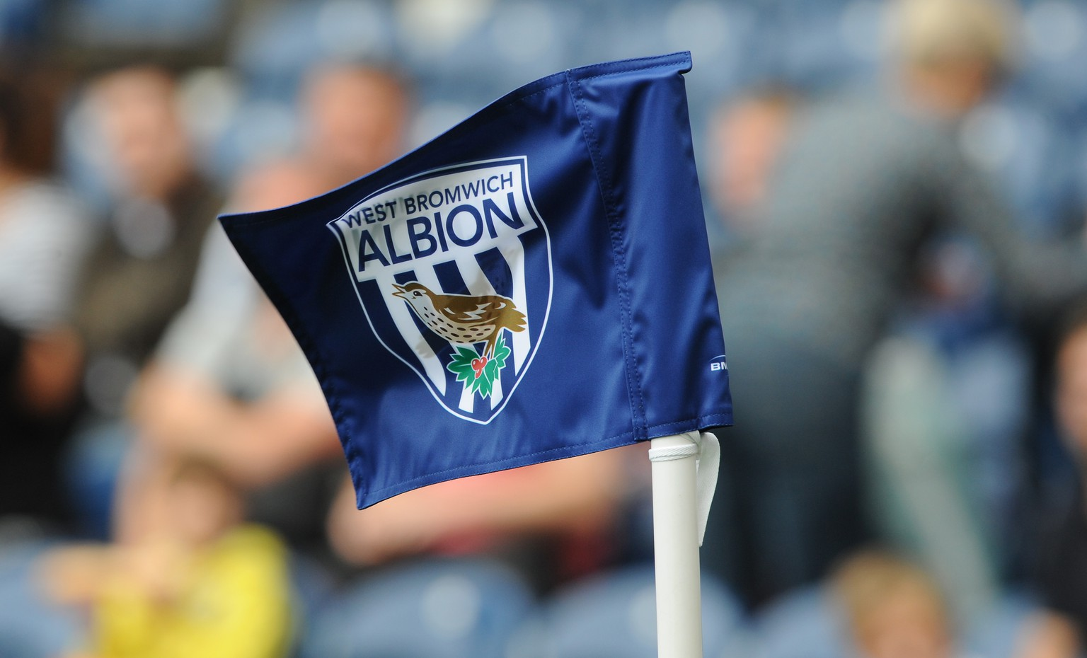 FILE - In this Sunday, Aug. 23, 2015, file photo, a West Bromwich corner flag flies during the English Premier League soccer match between West Bromwich Albion and Chelsea at the Hawthorns, West Bromwich, England. West Bromwich Albion says a Chinese investment group has agreed to buy the English Premier League club. West Brom said in a statement on Friday that Yunyi Guokai Sports Development Limited, headed by entrepreneur Lai Guochuan, will complete a takeover of the club subject to approval by the Premier League and English financial authorities. (AP Photo/Rui Vieira, FIle)