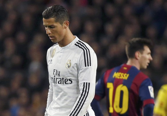 "Barcelona's Lionel Messi (R) and Real Madrid's Cristiano Ronaldo react during their Spanish first division ""Clasico"" soccer match at Camp Nou stadium in Barcelona, March 22, 2015.        REUTERS/Paul Hanna"