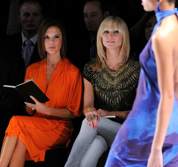 "Project Runway Judges Michael Kors, left, Heidi Klum,right, and Victoria Beckham attend Bravo Networks ""Project Runway"" final runway show during Fashion Week, Friday, Feb. 8, 2008, in New York.  (AP Photo/Peter Kramer)"