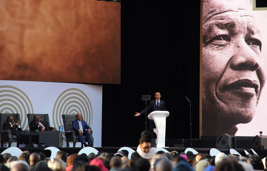 epa06894987 Former US President Barack Obama speaks during the annual Mandela Lecture to commemorate Mandela Day, Johannesburg, South Africa, 17 July 2018. Nobel Peace Prize winner Nelson Mandela 100 years ago and the lecture is part of a week long celebration of his life.  EPA/STR
