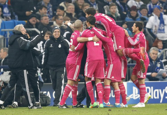 Real players celebrate after scoring their second goal during the Champions League round of 16 first leg soccer match between FC Schalke 04 and Real Madrid on Wednesday, Feb. 18, 2015 in Gelsenkirchen, Germany. (AP Photo/Frank Augstein)