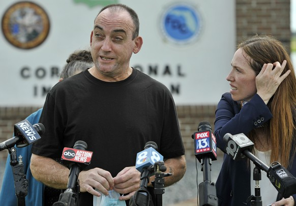 Former inmate Robert DuBoise, 56, and Innocent Project Staff Attorney Susan Friedman meet reporters outside the Hardee County Correctional Institute after serving 37 years in prison, when officials discovered new evidence that proved his innocence Thursday, Aug. 27, 2020, in Hardee County, Fla. (AP Photo/Steve Nesius)