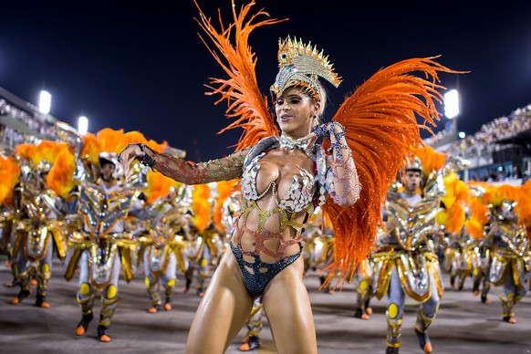 "RIO DE JANEIRO, BRAZIL - MARCH 03: Members of Unidos da Tijuca Samba School during their parade at 2014 Brazilian Carnival at Sapucai Sambadrome on March 03, 2014 in Rio de Janeiro, Brazil. Rio's two nights of Carnival parades began on March 2 in a burst of fireworks and to the cheers of thousands of tourists and locals who have previously enjoyed street celebrations (known as ""blocos de rua"") all around the city. (Photo by Buda Mendes/Getty Images)"
