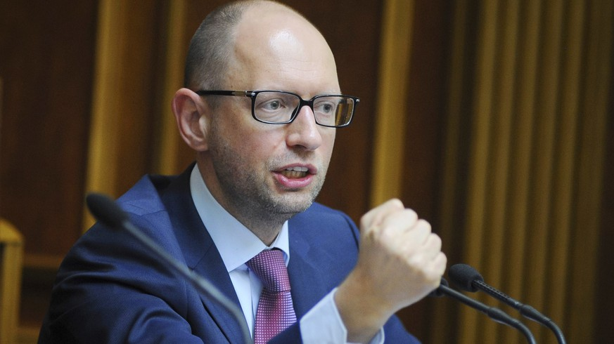 This handout picture taken and received by the Prime Minister press service on August 14, 2014 shows Ukrainian Prime Minister Arseniy Yatsenyuk gestures after voting at the Parliament during a session. Ukraine's Parliament on August 14 approved a law paving the way for a string of sanctions on Russian businesses and nationals accused of backing a separatist uprising in the east of the country. Kiev has drawn up a sanctions list of 65 mainly Russian companies and 172 individuals and the new law now gives Ukraine's National Security and Defence Council -- headed by the president -- the right to impose the punitive measures. AFP PHOTO/ PRIME MINISTER PRESS SERVICE/ ANDREW KRAVCHENKO
