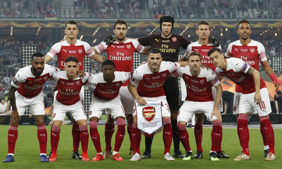Arsenal players pose before the Europa League Final soccer match between Chelsea and Arsenal at the Olympic stadium in Baku, Azerbaijan, Wednesday, May 29, 2019. (AP Photo/Darko Bandic)