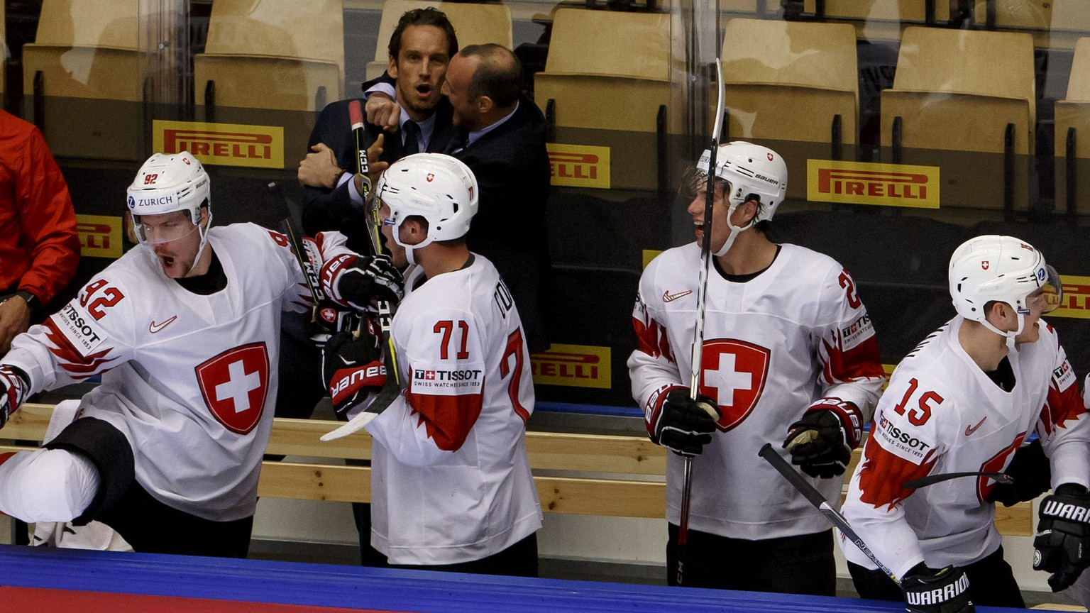 Switzerland's players celebrate their victory after beating Finland, during the IIHF 2018 World Championship quarter final game between Finland and Switzerland, at the Jyske Bank Boxen, in Herning, Denmark, Thursday, May 17, 2018. (KEYSTONE/Salvatore Di Nolfi)